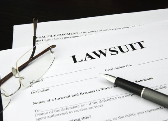 lawsuit form with glasses and pen