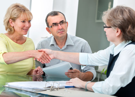 Mature couple getting financial advice from consultant at home