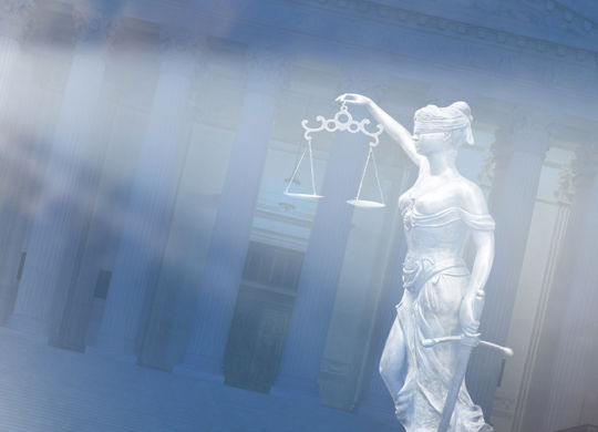 Statue of Lady of Justice in front  of Courthouse abstract justice concept
