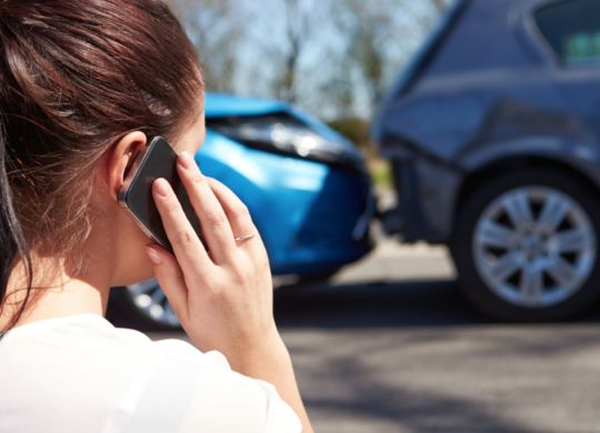 female-driver-making-phone-call-after-traffic-accident-picture-id456512005