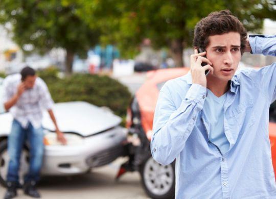 teenage-driver-making-phone-call-after-traffic-accident-picture-id475397425